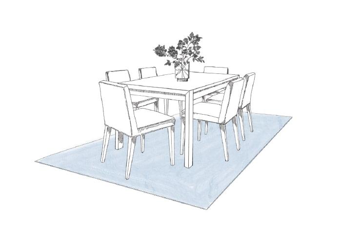 Rechteckiger Tisch mit sechs Stühlen, darunter ein bläulicher Teppich über den gesamten Sitzbereich